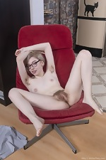 Abby enjoys masturbating on her chair - pic #16