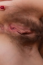 Agneta slides candy inside her hairy pussy - pic #11