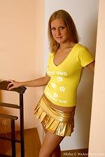 Take a peek up Alisha's gold mini skirt - pic #1