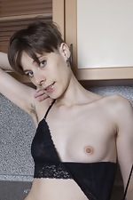 Amelinda strips naked on her kitchen counter - pic #4