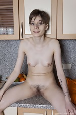 Amelinda strips naked on her kitchen counter - pic #12