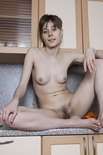 Amelinda strips naked on her kitchen counter - pic #13