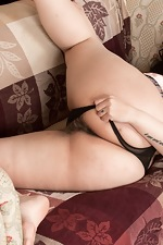 The busty Anastasia Lux strips naked by her sofa  - pic #6