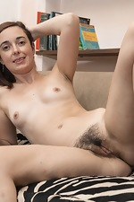 Anika poses in glasses as she strips naked - pic #10