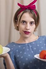 Anolia masturbates with her cucumber - pic #1
