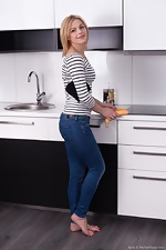 Ayda feels horny and strips naked in her kitchen - pic #1