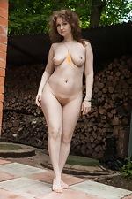 Bazhena strips naked in her outside garden  - pic #14