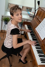 Calina strips naked while playing her piano - pic #1