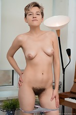 Calina strips naked while playing her piano - pic #7