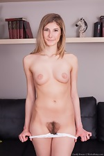 Candy Bloom strips naked on her leather sofa - pic #4