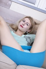 Candy Rose poses in her blue skirt - pic #3