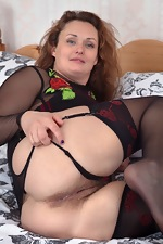 Cecelia Hart strips off her lingerie in bed - pic #4