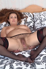 Cecelia Hart strips off her lingerie in bed - pic #14