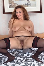 Cecelia Hart strips off her lingerie in bed - pic #16