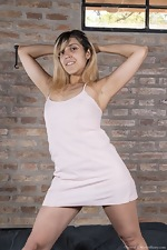 Christal strips nude by her brick wall - pic #1