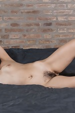 Christal strips nude by her brick wall - pic #13