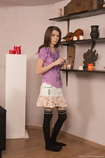 Christy lights candles and strips naked elegantly - pic #1