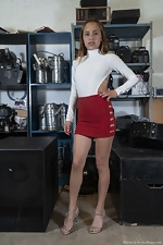 Clarita strips nude in her equipment warehouse - pic #1