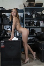 Clarita strips nude in her equipment warehouse - pic #8