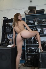 Clarita strips nude in her equipment warehouse - pic #15