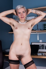 Cordelia shows her hairy pussy at work - pic #8