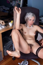 Cordelia shows her hairy pussy at work - pic #13