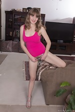 Dani strips off pink shirt to get naked  - pic #6