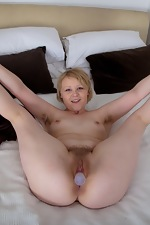 This toy disappears into Danniella's hairy pussy - pic #12