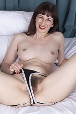 Destine masturbates in bed with a smile - pic #8