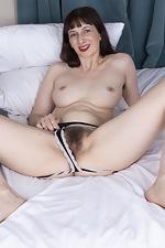 Destine masturbates in bed with a smile - pic #9