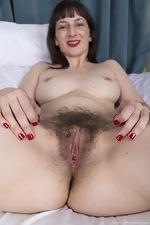 Destine masturbates in bed with a smile - pic #10
