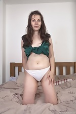 Effy strips off her white panties in bed - pic #4