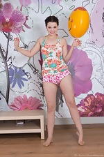 Ella Martin plays with balloon and strips naked  - pic #1