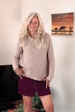 Ellen B poses in her ever short purple skirt - pic #1