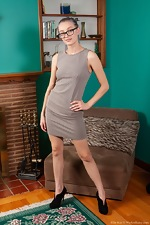 Ellie Kay enjoys stripping naked by a fireplace  - pic #1