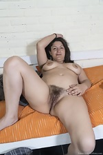 Emma strips nude in her rubber boots - pic #9