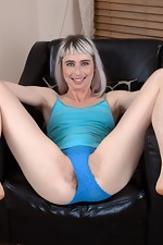 Esme strips naked on her black armchair  - pic #5