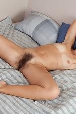 Cute girl Eva's pussy hair shows through panties - pic #7