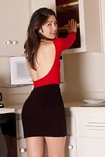 Felix has on a skin tight red top - pic #1