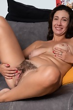 Gadget strips nude to masturbate on her sofa - pic #9