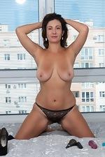 Gadget strips off her black dress to masturbate - pic #8