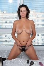 Gadget strips off her black dress to masturbate - pic #9