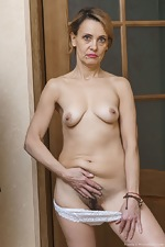 Ivanna strips naked to masturbate in her hallway - pic #10