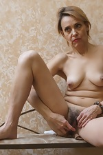 Ivanna strips naked to masturbate in her hallway - pic #13