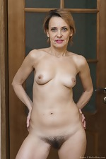 Ivanna strips naked to masturbate in her hallway - pic #16