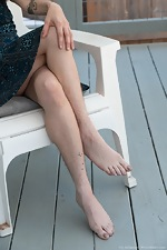 Ivy Addams strips naked on her outdoor chair - pic #1