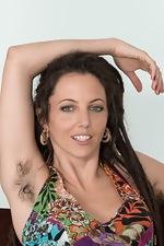 Jazmine Skye strips naked on her armchair  - pic #1
