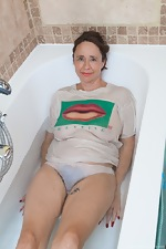 Josie strips nude before taking a sexy bath - pic #3