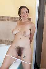 Josie strips nude before taking a sexy bath - pic #7