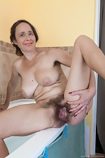 Josie strips nude before taking a sexy bath - pic #12